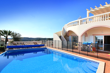 A villa with pool secured with a child safety gate and pool cover